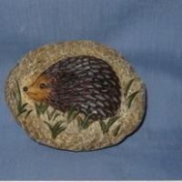 stone with hedgehog deco
